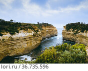 Loch Ard Gorge lookout with old airplane flying by in the distance... Стоковое фото, фотограф Mehul Patel / age Fotostock / Фотобанк Лори