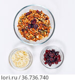 Healthy Mix of Muesli With Cranberries in Glass Bowl Top View. Стоковое фото, фотограф Zoonar.com/Marko Beric / easy Fotostock / Фотобанк Лори