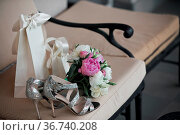 Wedding. Bouquet of pink, white flowers and greenery is in a chair... Стоковое фото, фотограф Zoonar.com/Konstantin Malkov / easy Fotostock / Фотобанк Лори
