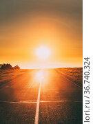 Sun Rising Above Asphalt Country Open Road In Sunny Sunrise Morning... Стоковое фото, фотограф Ryhor Bruyeu / easy Fotostock / Фотобанк Лори