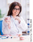 Woman dentist working on teeth implant. Стоковое фото, фотограф Elnur / Фотобанк Лори