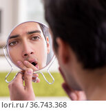 Man panicking because of pimples on the skin. Стоковое фото, фотограф Elnur / Фотобанк Лори
