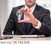 Businessman with light bulb in idea concept. Стоковое фото, фотограф Elnur / Фотобанк Лори