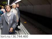 Brunette waiting for train on underground station. Стоковое фото, фотограф Яков Филимонов / Фотобанк Лори