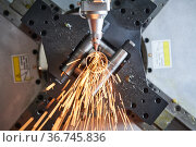Fiber laser tube cutting machine. metal pipe cutting with sparks. Стоковое фото, фотограф Дмитрий Калиновский / Фотобанк Лори