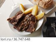 roasted veal ribs with potato. Стоковое фото, фотограф Яков Филимонов / Фотобанк Лори