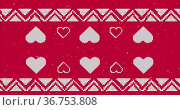 Traditional Christmas pattern with multiple hearts against red background. Стоковое фото, агентство Wavebreak Media / Фотобанк Лори
