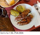 Grilled pig trotters with potato, homemade dinner. Стоковое фото, фотограф Яков Филимонов / Фотобанк Лори