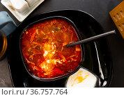 Russian cuisine - solyanka soup with various ingredients closeup. Стоковое фото, фотограф Яков Филимонов / Фотобанк Лори