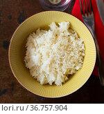 Cooked white rice in bowl close up, food concept. Стоковое фото, фотограф Яков Филимонов / Фотобанк Лори