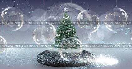 Image of snow globe with christmas tree over christmas baubles decoration