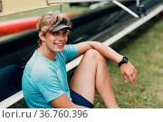 Sportsman single scull man rower portrait sitting relaxing after training... Стоковое фото, фотограф Zoonar.com/Max / easy Fotostock / Фотобанк Лори