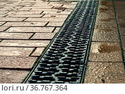 The drainage on the sidewalk, drainage and paving. Стоковое фото, фотограф Zoonar.com/ZimaNadezhda / easy Fotostock / Фотобанк Лори
