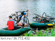 Kaliningrad region, Russia, June 11, 2018, crossing the river with... Стоковое фото, фотограф Zoonar.com/NadyZima_klgd / age Fotostock / Фотобанк Лори