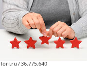 Customer experience feedback concept. Five red stars, the best rating... Стоковое фото, фотограф Zoonar.com/DANK0 NN / easy Fotostock / Фотобанк Лори