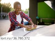 Woman using sponge with foam, hand car wash. Стоковое фото, фотограф Tryapitsyn Sergiy / Фотобанк Лори