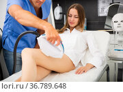 Woman getting IPL therapy procedure on legs. Стоковое фото, фотограф Яков Филимонов / Фотобанк Лори