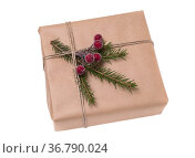 Christmas gift box wrapped in kraft paper. Isolated on white background... Стоковое фото, фотограф Zoonar.com/vkph / easy Fotostock / Фотобанк Лори