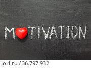 Motivation word handwritten on chalkboard with heart symbol instead... Стоковое фото, фотограф Zoonar.com/Yury Zap / easy Fotostock / Фотобанк Лори