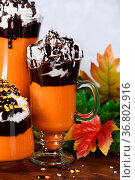 Pumpkin chocolate beverage with whipped cream and chocolate topping. Стоковое фото, фотограф Zoonar.com/Maryna Voronova / easy Fotostock / Фотобанк Лори