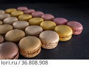 Chocolate, coffee, vanilla, lemon and strawberry macaroons on black... Стоковое фото, фотограф Richard Semik / easy Fotostock / Фотобанк Лори