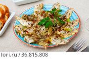 Spicy marinated herring fillet on a plate. Стоковое фото, фотограф Яков Филимонов / Фотобанк Лори