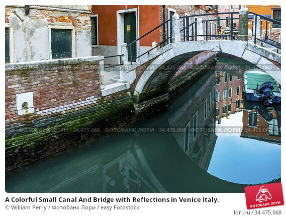 A Colorful Small Canal And Bridge with Reflections in Venice Italy. Стоковое фото, фотограф William Perry / easy Fotostock / Фотобанк Лори