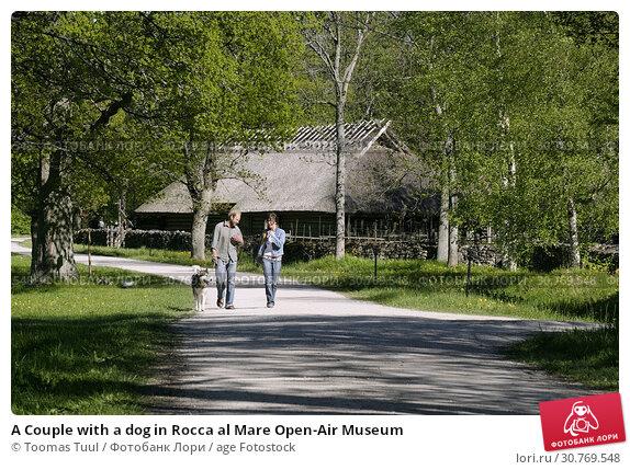 Купить «A Couple with a dog in Rocca al Mare Open-Air Museum», фото № 30769548, снято 25 мая 2019 г. (c) age Fotostock / Фотобанк Лори