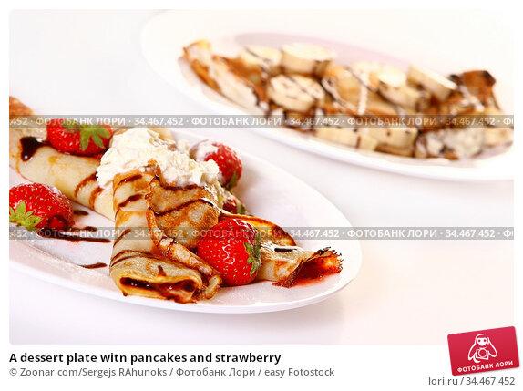 A dessert plate witn pancakes and strawberry. Стоковое фото, фотограф Zoonar.com/Sergejs RAhunoks / easy Fotostock / Фотобанк Лори