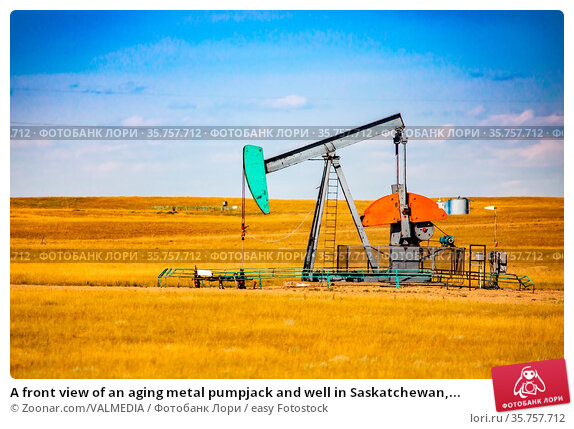 A front view of an aging metal pumpjack and well in Saskatchewan,... Стоковое фото, фотограф Zoonar.com/VALMEDIA / easy Fotostock / Фотобанк Лори