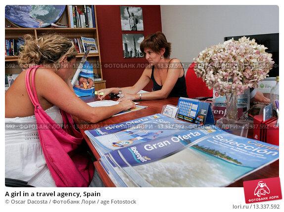 Купить «A girl in a travel agency, Spain», фото № 13337592, снято 13 августа 2010 г. (c) age Fotostock / Фотобанк Лори