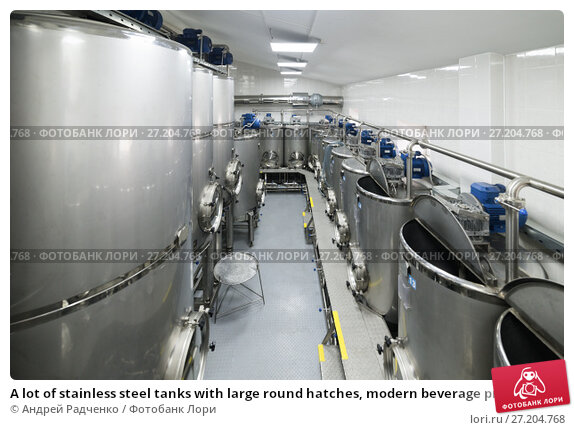 Купить «A lot of stainless steel tanks with large round hatches, modern beverage production.», фото № 27204768, снято 5 июля 2017 г. (c) Андрей Радченко / Фотобанк Лори