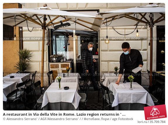 A restaurant in Via della Vite in Rome. Lazio region returns in ' ... Редакционное фото, фотограф Alessandro Serrano' / AGF/Alessandro Serrano' / / age Fotostock / Фотобанк Лори
