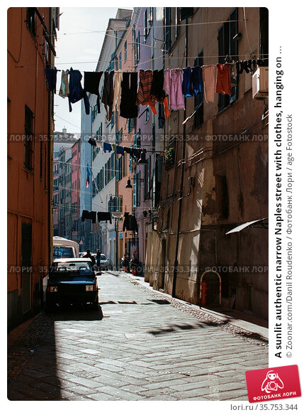 A sunlit authentic narrow Naples street with clothes, hanging on ... Стоковое фото, фотограф Zoonar.com/Danil Roudenko / age Fotostock / Фотобанк Лори
