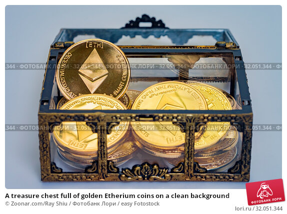 A treasure chest full of golden Etherium coins on a clean background. Стоковое фото, фотограф Zoonar.com/Ray Shiu / easy Fotostock / Фотобанк Лори