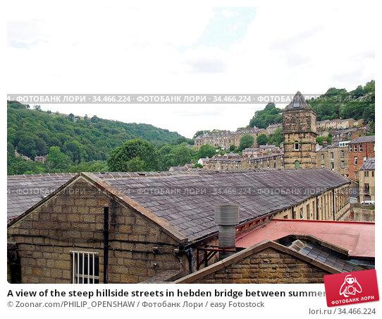 A view of the steep hillside streets in hebden bridge between summer... Стоковое фото, фотограф Zoonar.com/PHILIP_OPENSHAW / easy Fotostock / Фотобанк Лори