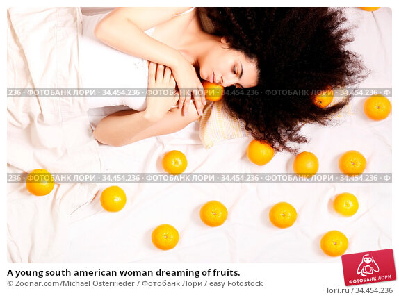 A young south american woman dreaming of fruits. Стоковое фото, фотограф Zoonar.com/Michael Osterrieder / easy Fotostock / Фотобанк Лори