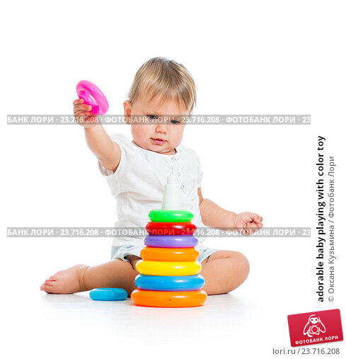 Купить «adorable baby playing with color toy», фото № 23716208, снято 15 сентября 2012 г. (c) Оксана Кузьмина / Фотобанк Лори