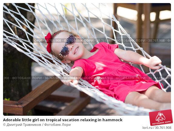 Купить «Adorable little girl on tropical vacation relaxing in hammock», фото № 30761908, снято 31 марта 2015 г. (c) Дмитрий Травников / Фотобанк Лори
