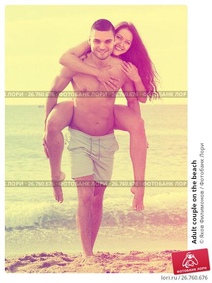 Купить «Adult couple on the beach», фото № 26760676, снято 25 июня 2014 г. (c) Яков Филимонов / Фотобанк Лори