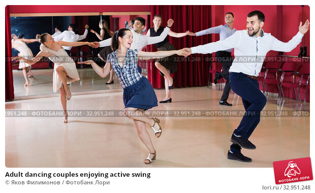 Adult dancing couples enjoying active swing. Стоковое фото, фотограф Яков Филимонов / Фотобанк Лори