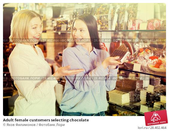 Купить «Adult female customers selecting chocolate», фото № 28402464, снято 23 февраля 2019 г. (c) Яков Филимонов / Фотобанк Лори
