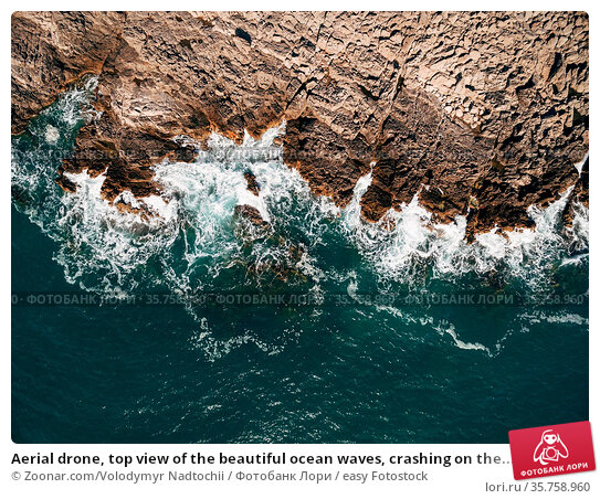 Aerial drone, top view of the beautiful ocean waves, crashing on the... Стоковое фото, фотограф Zoonar.com/Volodymyr Nadtochii / easy Fotostock / Фотобанк Лори