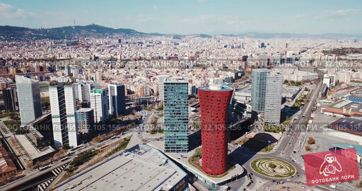 Купить «Aerial panoramic view of modern neighborhood of Gran Via with skyscrapers on Plaza de Europa and convention center of Fira de Barcelona», видеоролик № 32105156, снято 12 апреля 2019 г. (c) Яков Филимонов / Фотобанк Лори