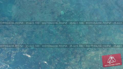Купить «Aerial shot of blue ocean surface and foamy waves», видеоролик № 25622180, снято 4 ноября 2016 г. (c) Данил Руденко / Фотобанк Лори