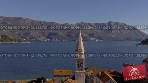 Купить «Aerial View - Adriatic Sea Near Old Town Budva», видеоролик № 28598768, снято 23 февраля 2018 г. (c) Pavel Biryukov / Фотобанк Лори