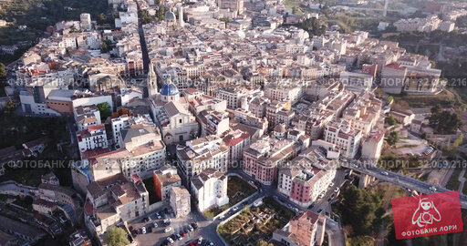 Купить «Aerial view of Alcoi cityscape with blue dome of Archpriest church of Santa Maria, Spain», видеоролик № 32069216, снято 16 апреля 2019 г. (c) Яков Филимонов / Фотобанк Лори