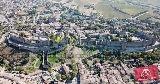 Купить «Aerial view of Carcassonne cityscape with medieval fortress of Cite de Carcassonne, Aude, Occitanie, France», видеоролик № 30323060, снято 26 октября 2018 г. (c) Яков Филимонов / Фотобанк Лори