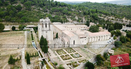 Купить «Aerial view of Castle of Abbey Sainte-Marie d'Orbieu in Lagrasse, France», видеоролик № 30322744, снято 26 октября 2018 г. (c) Яков Филимонов / Фотобанк Лори