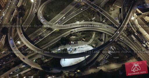 Купить «Aerial view of lighted highway road junctions at night», видеоролик № 32251668, снято 26 октября 2018 г. (c) Яков Филимонов / Фотобанк Лори